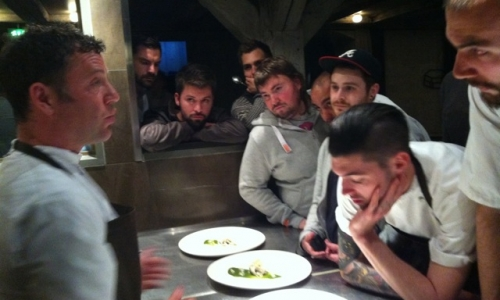 Chef Timothy Magee explaining his dishes to the colleagues at Noma in Copenhagen, Denmark