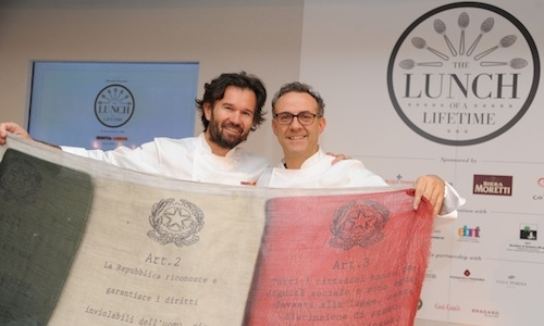 L'ITALIA S'E' DESTA. Carlo Cracco from the homonymous restaurant in Milan and Massimo Bottura of Osteria Francescana in Modena hold the Italian flag at The Georgian, on the fourth floor of Harrods, the stage for the 2013 edition of Identit� London, a splendid lunch devised together with Gennaro Esposito, Enrico and Roberto Cerea, Davide Scabin, Luciano Monosilio (photo and photo-gallery by Eamonn McCormack)