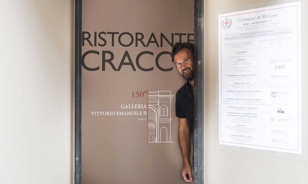 Carlo Cracco appears on the door of his new restaurant in Galleria Vittorio Emanuele in Milan. It should open in mid-February (photo by Brambilla-Serrani)