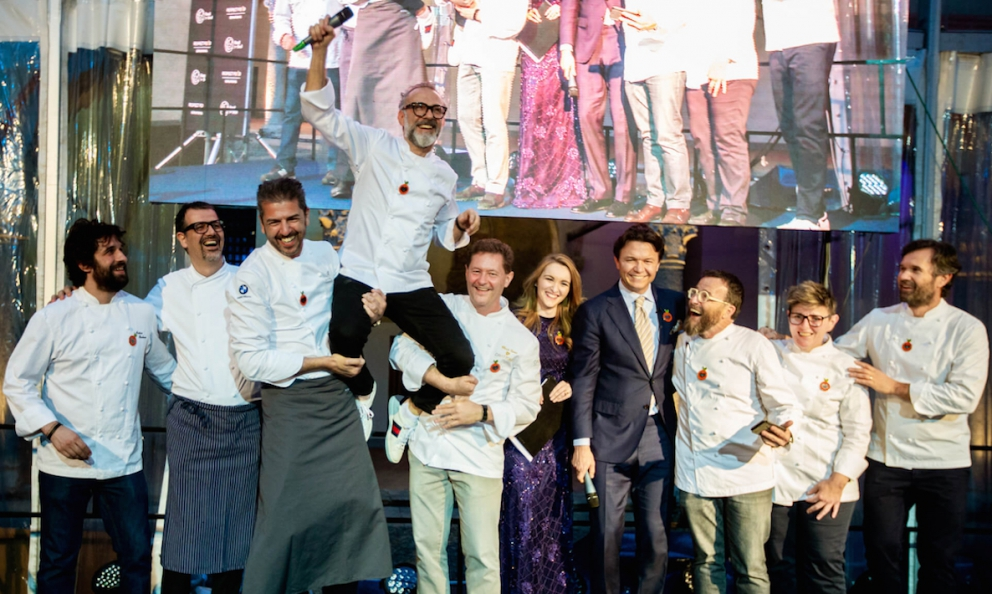 A souvenir photo of a nice charity event on April 19th at the Sforza Castle in Milano. Everyone cooked to support Food for Soul and Refettorio Ambrosiano. Left to right: Matias Perdomo, Antonio Guida, Andrea Berton and Enrico Cerea together lift a beaming Massimo Bottura. After Cerea and the presenter, Hakan Bulgurlu, general manager at Arçelik, Giancarlo Morelli, Viviana Varese and Carlo Cracco