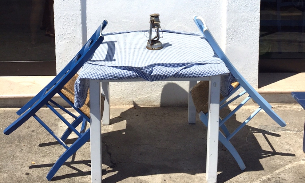 A detail ofTaverna del portoin Tricase Porto, Salento. A table perfect for waiting for a latecomer. Or if you're the one who's early