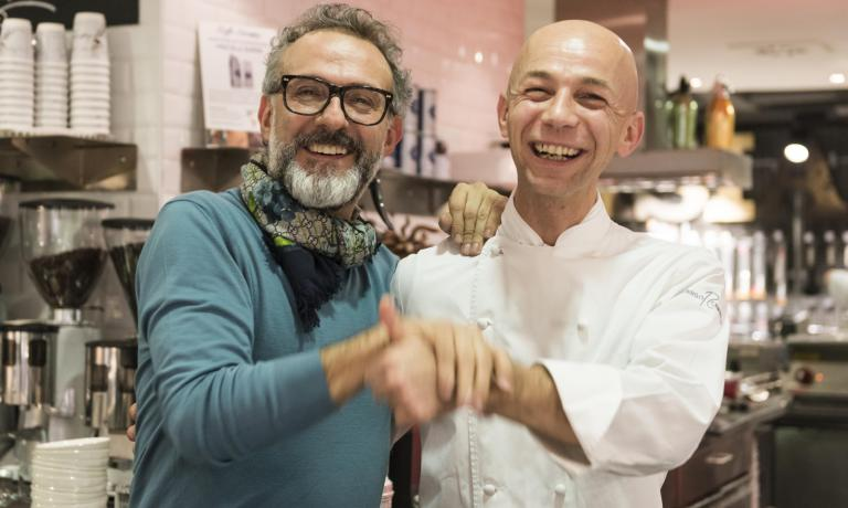 "Massimo Bottura and Riccado Camanini joke during the dinner that had Bergamo's chef from Lido 84 as the protagonist, with his most famous dishes, and the chef from Modena sitting at the table. The event is part of the ""Storie di gusto e di passione - Viaggio alla scoperta dei protagonisti della nuova cucina italiana� project organised by Coincasa with Cargo Etc. in collaboration with Identità Golose (photo Brambilla-Serrani)"