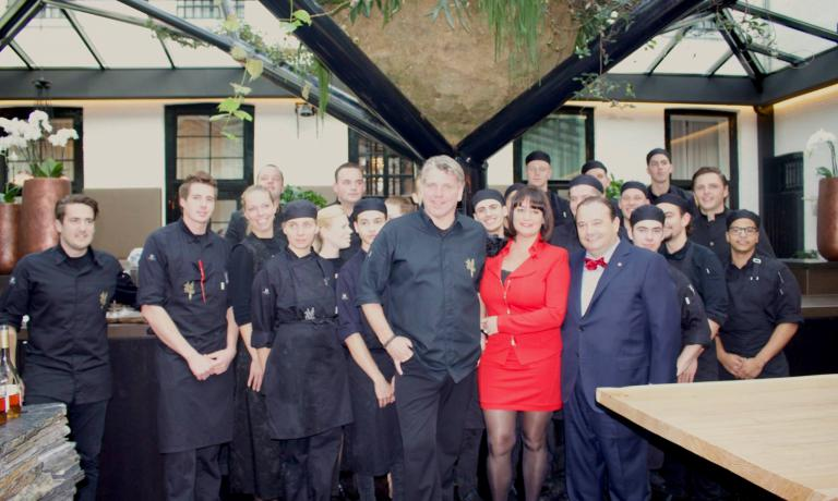 In the middle, taller than the others, chef Jonnie Boer with the entire team of restaurant De Librije, 3 Michelin stars in Zwolle, The Netherlands, tel.+31.(0)38.8530000. Beside him, his wife Therese, sommellier in the same establishment, and next to her Josè Gomez, fourth generation of Joselito ham producers, considered the best  jamón in the world