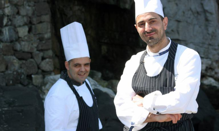 Domenico De Simone, chef at Bikini. Behind him, his sous chef Antonino De Simone