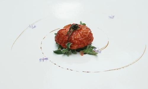 Withered tomato with rock anemone and juniper aromatised oil: �as if it had been forgotten on the plant, it concentrated its aromas�, explains author Sergio Bastard, chef at La Casona del Jud�o in Calle Repuente 20 in Santander (Cantabria, Spain), tel. +34.670.953327. According to Iberian critics, Bastard is one of the most interesting promises in the country