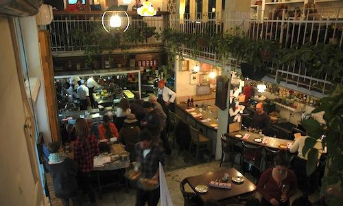 The Machneyuda restaurant in Jerusalem, Israel, 10 beit yaakov 10 street, tel. +972.053.8094897. Run by 3 young chefs, it's a market restaurant: dishes are prepared directly on the table with the early produce from the nearby Mahane Yehuda market