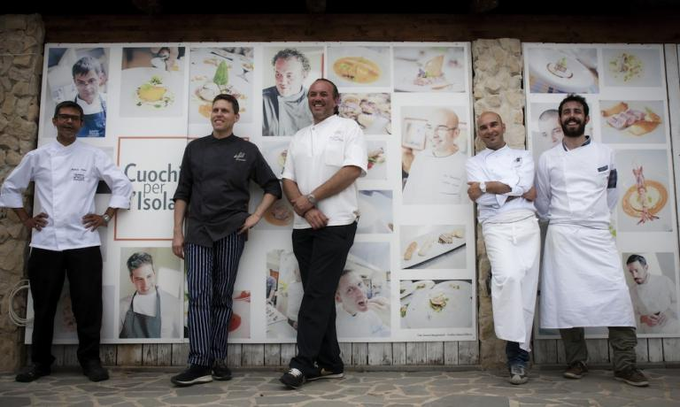 A group photo of the chefs of the association Cuochi per l'Isola [chefs for the Island], founded at the end of 2013 to help the people who suffered from the floods on November 18th 2013. Left to right we can see Roberto Petza, Achille Pinna, Luigi Pomata, Roberto Serra and Pierluigi Fais.�The group is very active, with a long series of activities that have the objective of promoting Sardinia's gastronomic heritage with attention, and encourage the new generations of professionals (photo by Pietro Pio Pitzalis)