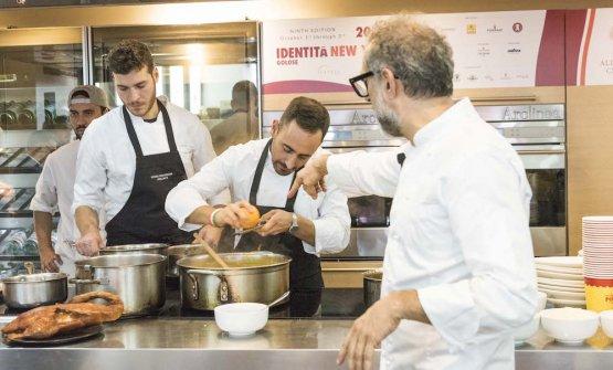 MAKE WAY FOR THE YOUNG GENERATIONS. BehindBottura, his secondDavide Di FabioandFrancesco Vincenzi, in the kitchen atFranceschetta 58