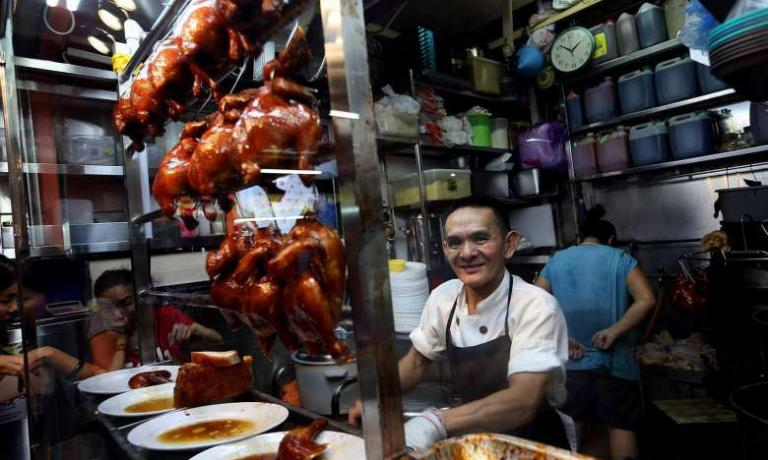 Chan Hon Meng, chef at Hong Kong Soya Sauce Chicken Rice & Noodle in Singapore, the cheapest Michelin star restaurant in the world (photo credits St File)