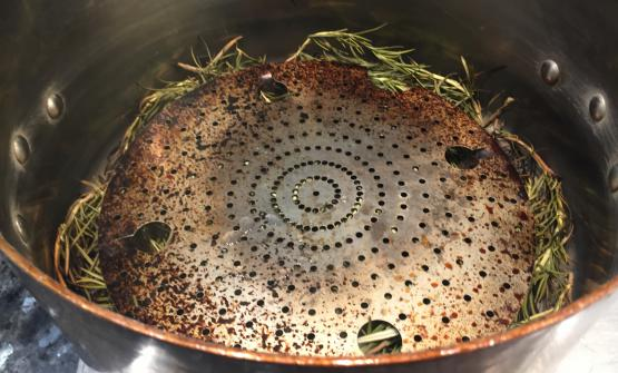 STEP ONE. Put in a copper pot (with a grill) lots of rosemary and light the fire