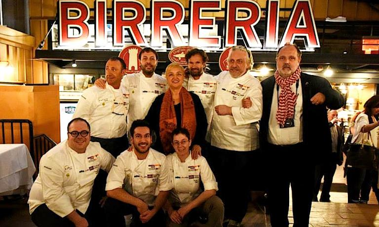 A souvenir photo after the first gala dinner at Identit� New York on the last floor of Eataly, inside the Birreria. Standing, in second row, left to right: Fortunato Nicotra, Ugo Alciati, Lidia Bastianich, Carlo Cracco, Davide Scabin and Paolo Marchi. Leaning, again left to right, Vitantonio Lombardo, Denny Imbroisi e Katia Delogu. Right when the photo was taken, Rosanna Marziale was missing