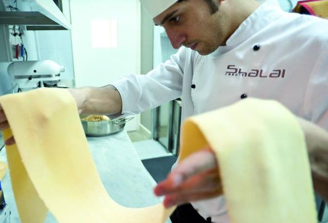 Giovanni Santoro at work: he's the 30-year-old chef at the Shalai Resort in Linguaglossa (Ct)