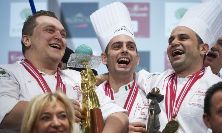 The Italians rejoicing during the prize giving ceremony in Lyon: they won the 2015 World Pastry Cup. Left to right, EmmanueleForcone,    Francesco Boccia and