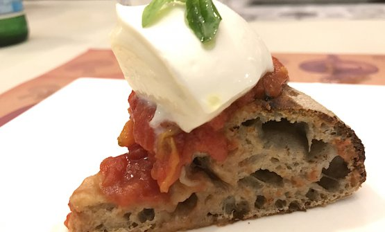 "A slice of pizza Bufalina: ""Terra Amore e Fantasia""San Marzanotomato, Mozzarella di Bufala Campana PDO, fresh basil. Hydrolysis dough and, to finish, the lovely Apulian extra virgin olive oilIntini, fruttato 2017"
