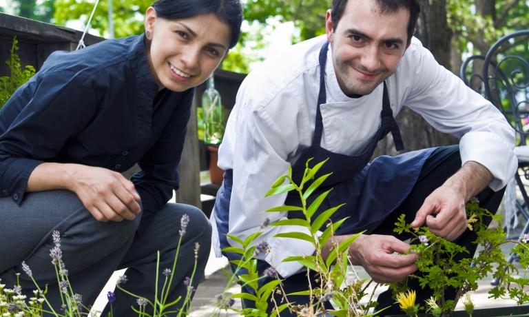 Alessandro Bellingeri, awarded as best emerging chef in Italy in 2012, together with wife Perla in the vegetable garden of their Osteria de l'Acquarol, tel. +39.0462.813082 . He trained in the kitchens of great chefs such as Crippa and Bottura, and based his style on a research focused on the essence of the products bestowed by nature
