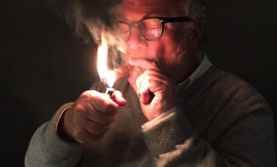 A portrait of Antonello Colonna lighting a Cohiba