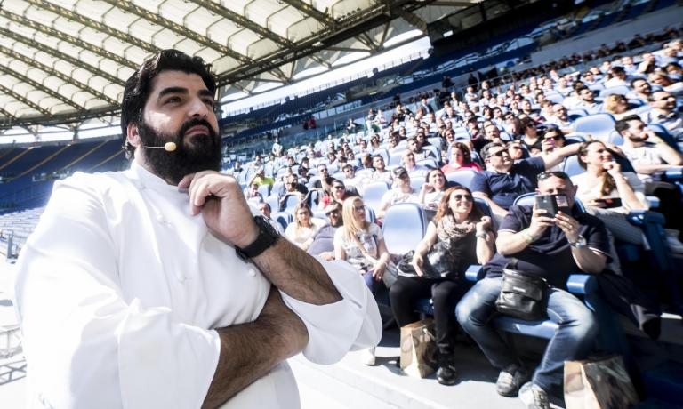 Another pic from the Stadio Olimpico. The chef's stardom began in 2013 with Cucine da Incubo (as of this year on Deejay Tv-Nove),the Italian version of Ramsay's Kitchen Nightmares, now in its fourth season (photo by Carlo Lannutti for cucina.corriere.it)
