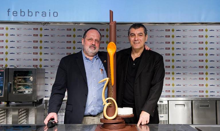 Paolo Marchi and Claudio Ceroni together on the stage of the latest edition of the Identit� Golose congress, with the �sweet sculpture prepared by Gianluca Fusto to celebrate its tenth anniversary