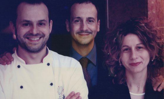 Nicola and Pierluigi Portinari, with Cinzia Boggian, wife of the latter and a great dining room woman, in a photo from 1999