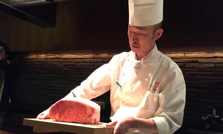 The chef at restaurant Kobe Plaisir in Kobe holds two magnificent beef entrecÃtes on a tray. The meat from Kobe is one of the world's most famous culinary symbols of the Hyogo prefecture, 560 kilometres South-West of Tokyo. A land of great products, from saké to black soy beans, from Asakuro pepper to Awaji onions. We discovered them during a five-day trip, organised by Jetro Kobe and Jetro Italia (photo and photo gallery by Zanatta)