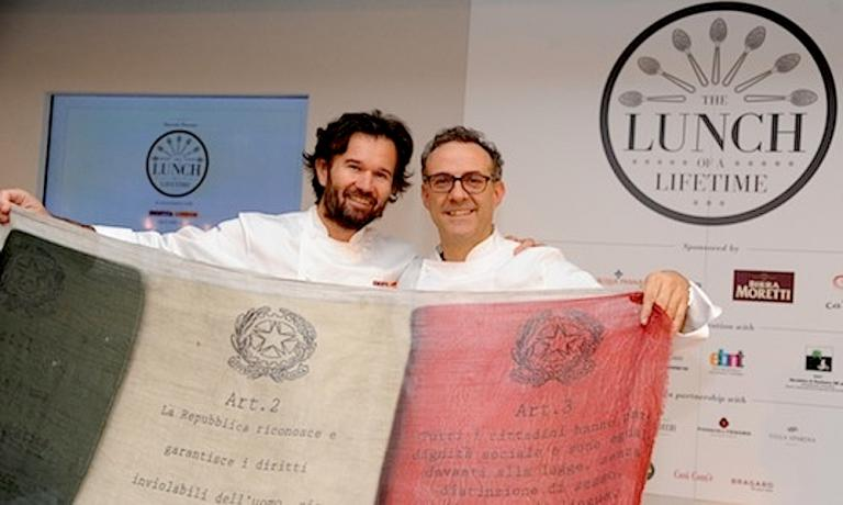 Carlo Cracco and Massimo Bottura fold out the Italian flag at the super-lunch held at Harrods in London on 28th April 2013 when seven Italian chefs gave life to what the English called The Lunch of a Lifetime