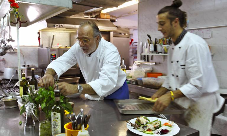 Luciano Zazzeri at work in the kitchen of La Pineta, with his son Daniele, while the other son, Andrea runs the dining room and cellar: this restaurant in Marina di Bibbona is a favourite destination among many food lovers, even famous ones, such as the great Angelo Gaja
