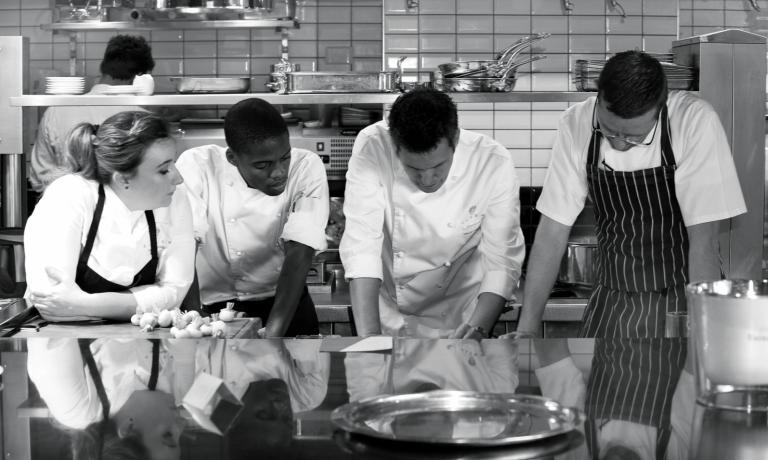 David Higgs in the kitchen with his collaborators
