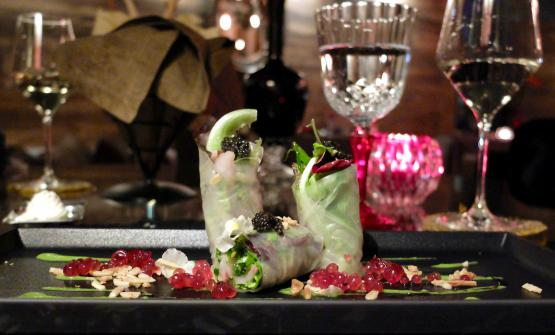 Slightly smoked sturgeon wrapped in rice paper with cream of broccoli, pomegranate gelatine and toasted almonds