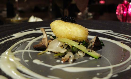 Breaded poached egg fried with vegetables and sesame and a fondue of Parmigiano, pearls of truffle