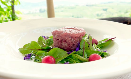Mangalitza pork tartare with radishes and red bean leaves
