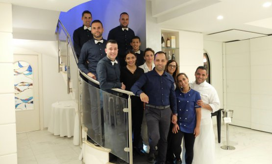 The staff at Gambero Rosso in Marina di Gioiosa Ionica: left to right Giuseppe Marando, Stefano Frascà, Giuseppe Figliomeni, Salvatore Frascà, Tiziana Sculli, Jousset Ghezy, Mirela Barbu, Francesco Sculli, Caterina Favasuli, Chiara Fiorenza and chef Riccardo Sculli