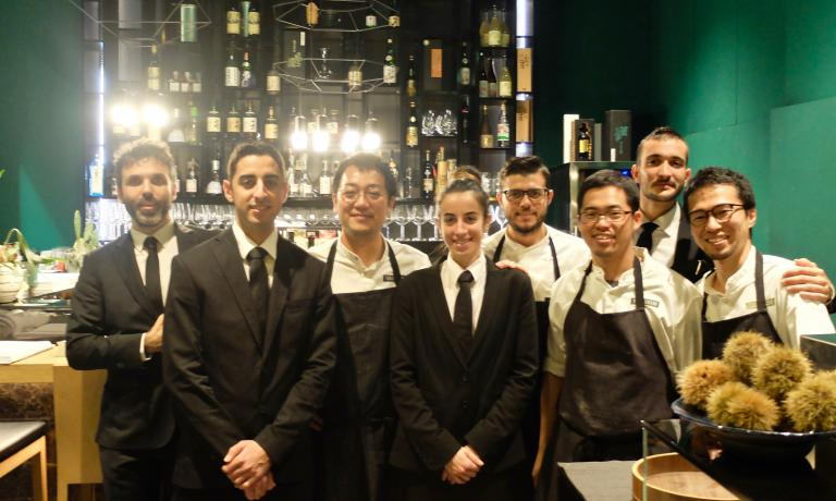 "Yoji Tokuyoshi with his kitchen and dining room teams, in the photo by Tanio Liotta. The Japanese chef is pursuing an original mix of Italian and Japanese cuisine, which he calls ""contaminated cuisine"