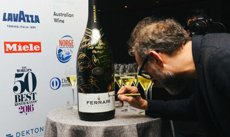 Massimo Bottura on the night of the 13th of June in New York, after his brand new victory in the 2016 World's 50 Best Restaurants, signs a magnum of Metodo Classico Ferrari. Copyright The World�s 50 Best Restaurants
