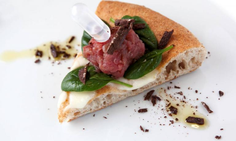 One of Simone Padoan�s pizzas with Sabad� chocolate: grated on a beef and spinach tartare, with Prime Uve spirit