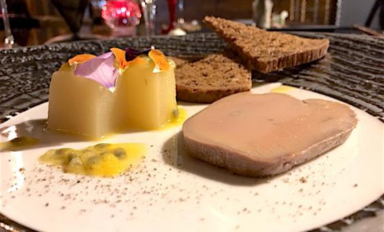 Goose foie gras terrine cooked in sweet salt from Cervia and marinated in extra virgin olive oil with gelatine of apples with passion fruit
