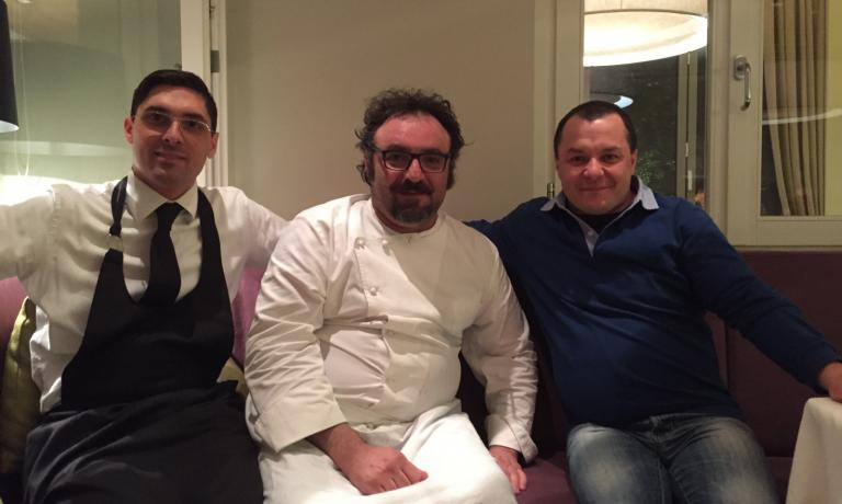 Paolo Lopriore at the end of the farewell dinner at Kitchen in Como. To the left, his ma�tre Stefano Gaiofatto, to the right, fisherman Simone Fraquelli