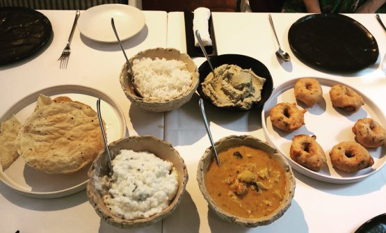 Gaggan Anand is also a great cook when it comes to traditional Indian cuisine. The proof is on this table. Left to right, clockwise: poppadum, rice, coconut chutney, fried lentil doughnuts, fish curry, curdled rice