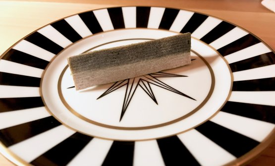 This is not a sardine: bread wafer with cream of eel. A reference to Magritte