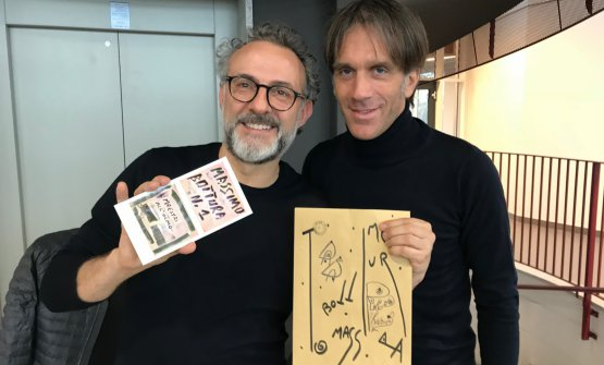 Massimo Bottura and Davide Oldani at Olmo in Cornaredo. The chef from Modena shows the gift the school gave him, a work dedicated to him by artist Maurizio Galimberti