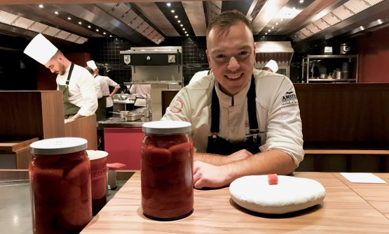 Not preserves, but a semi-preserve: they boil the tomatoes in a vacuum jar for 8 minutes only, then put them into a solution with calcium which preserves texture and aromas. In the picture, some of the jars, with sous chef Jeffrey Van Zijl