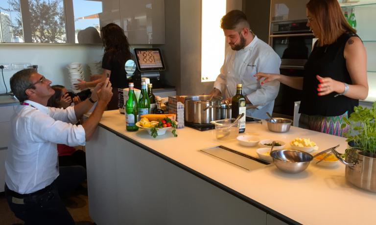 Riccardo Felicetti takes a picture of Colombo during the cooking demo