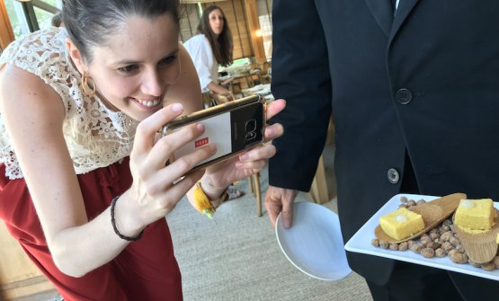 A Spanish journalist takes photos of the formidable tapas during the event dedicated to the excellentJoselito: Chorizo marshmallows and corn