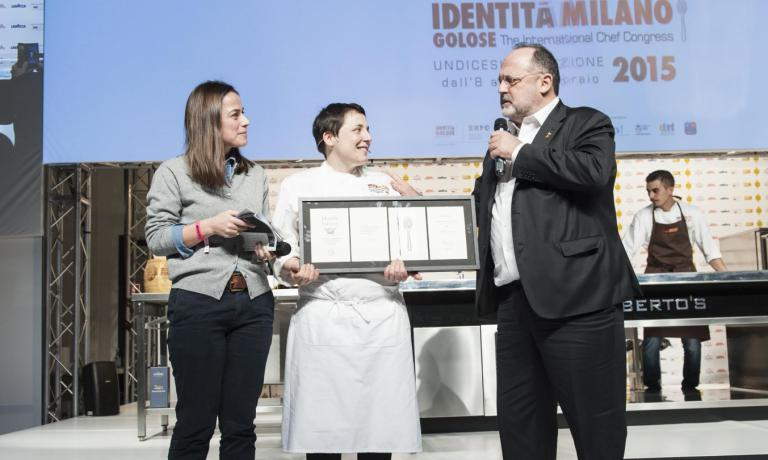 Antonia Klugmann on the stage of Identit� Milano 2015 together with Paolo Marchi and Laura Lazzaroni who presented her lecture at the congress. On 17th December she opened her own restaurant, after two years of great success as chef at restaurant Venissa, in Venice, where she also got a Michelin star