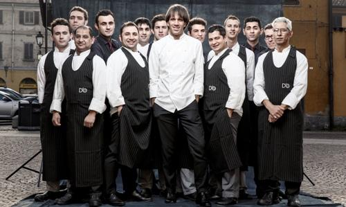 The actual team of restaurant�D'O�in San Pietro all'Olmo, a little village closed to Cornaredo, a town in the North-western sorroundings of Milan. In the center, chef Davide Oldani, born in 1969 and previously working with�Alain Ducasse, Gualtiero Marchesi and Albert and Michel Roux