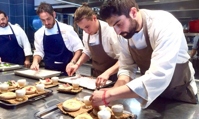 Riccardo Gaspari yesterday at Alice in Milan as he was dishing out his Pizza Moretti, the dish that got him to win the fifth edition of Premio Birra Moretti Grand Cru