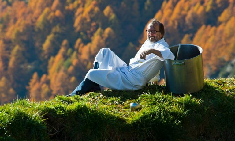 Norbert Niederkofler lying down among his pastures in the Dolomites. The chef at St. Hubertus in San Cassiano (Bolzano), 2 Michelin stars, has recently become the promoter of Cook the Mountains, a project that aims at promoting the whole food supply in the mountains. He will illustrate the details at Identit� di Montagna, Identit� Milano's new-born format, on Sunday 8th of February 2015