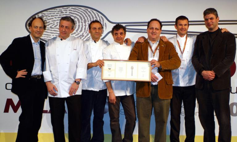 The New Italian Cuisine in 2006, at the second edition of Identità Golose in Milan. Every era has had its series of new brilliant chefs. The ones in the past decades, all without a beard at the time, are perfectly summed up in this photo showing, left to right, Moreno Cedroni, Davide Scabin, Massimo Bottura, Mauro Uliassi, Paolo Marchi, Carlo Cracco and Pietro Leemann. Unfortunately Massimiliano Alajmo, the youngest star in the global history of the Michelin Guide, was already on his way back to Padua and couldn't take part in the souvenir photo with a group that is still making the history of Italian and global cuisine