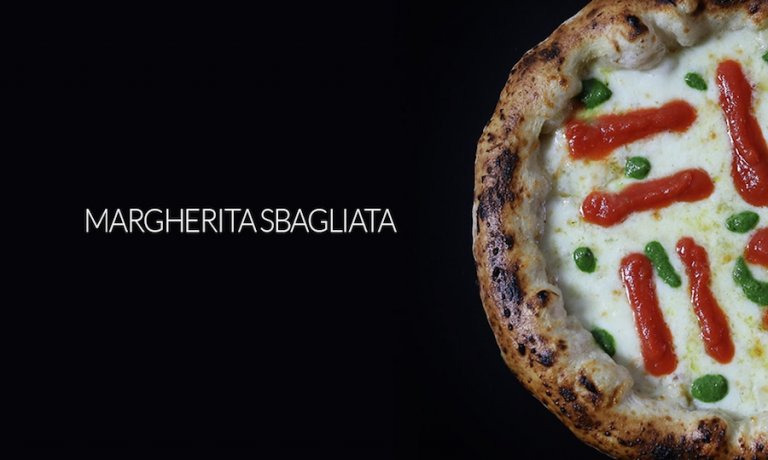 Margherita sbagliata, the emblem-dish by Franco Pepe, master pizzaiolo from Caiazzo (Caserta)