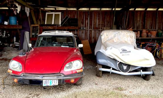 Under a canopy at Ayers Creek Farm, in Gaston, Oregon. Owner Anthony Boutard fixed two incredible Citroën models that made car history: a DS family car (to the left) and even a Traction Avant