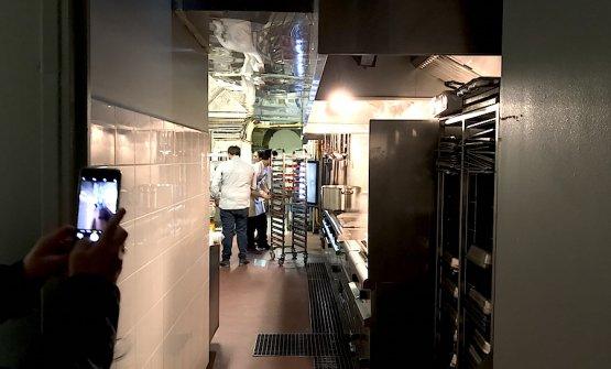 The narrow kitchen in the Parisian Refettorio
